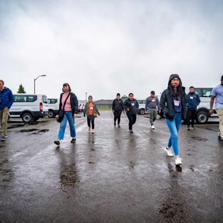 TRACE employees walking in parking lot on a cloudy, wet day in Newport, Oregon